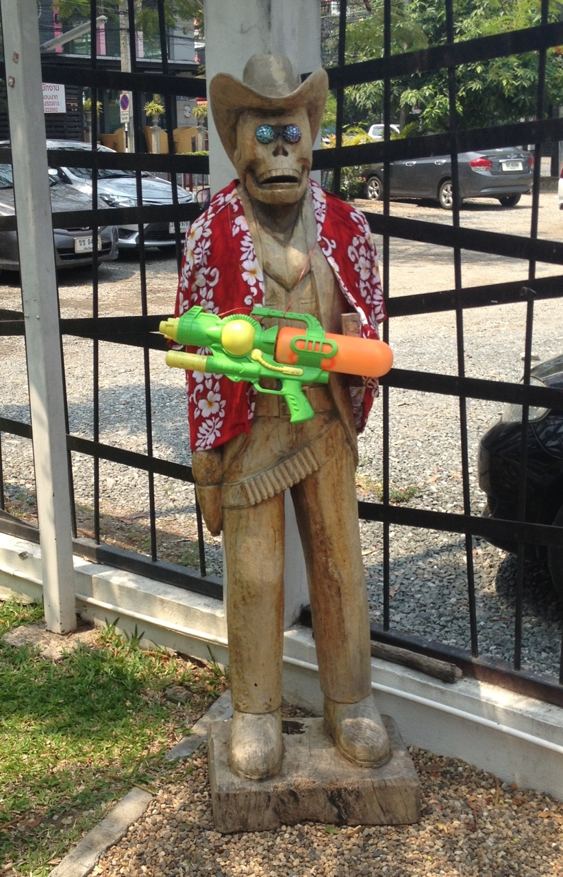 Water gun is for Songkran, but what wooden skeleton in cowboy hat doing in Chiang Mai