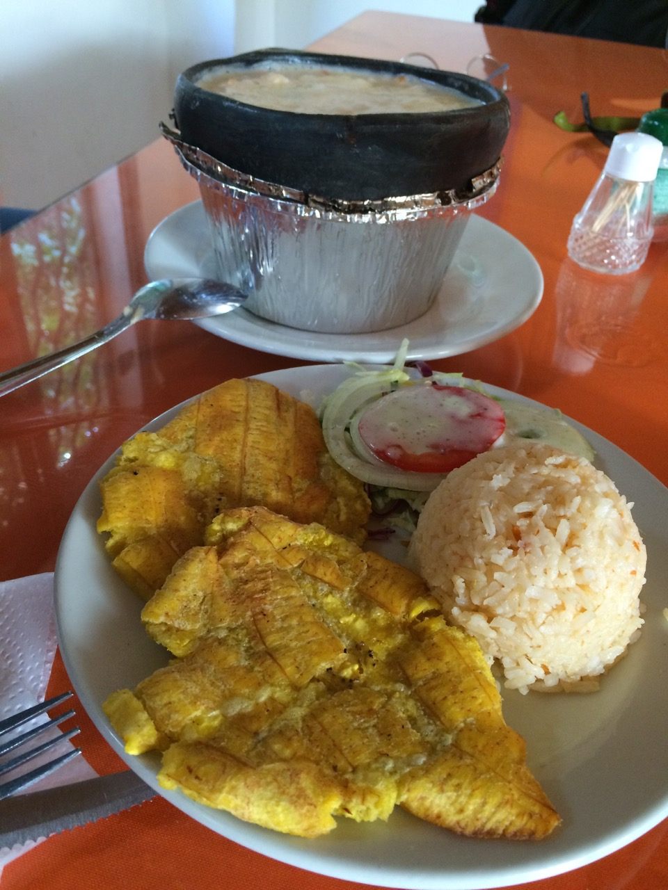 The cazuela de mariscos served with fried plantains