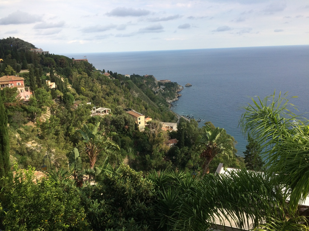 What draws visitors to Taormina