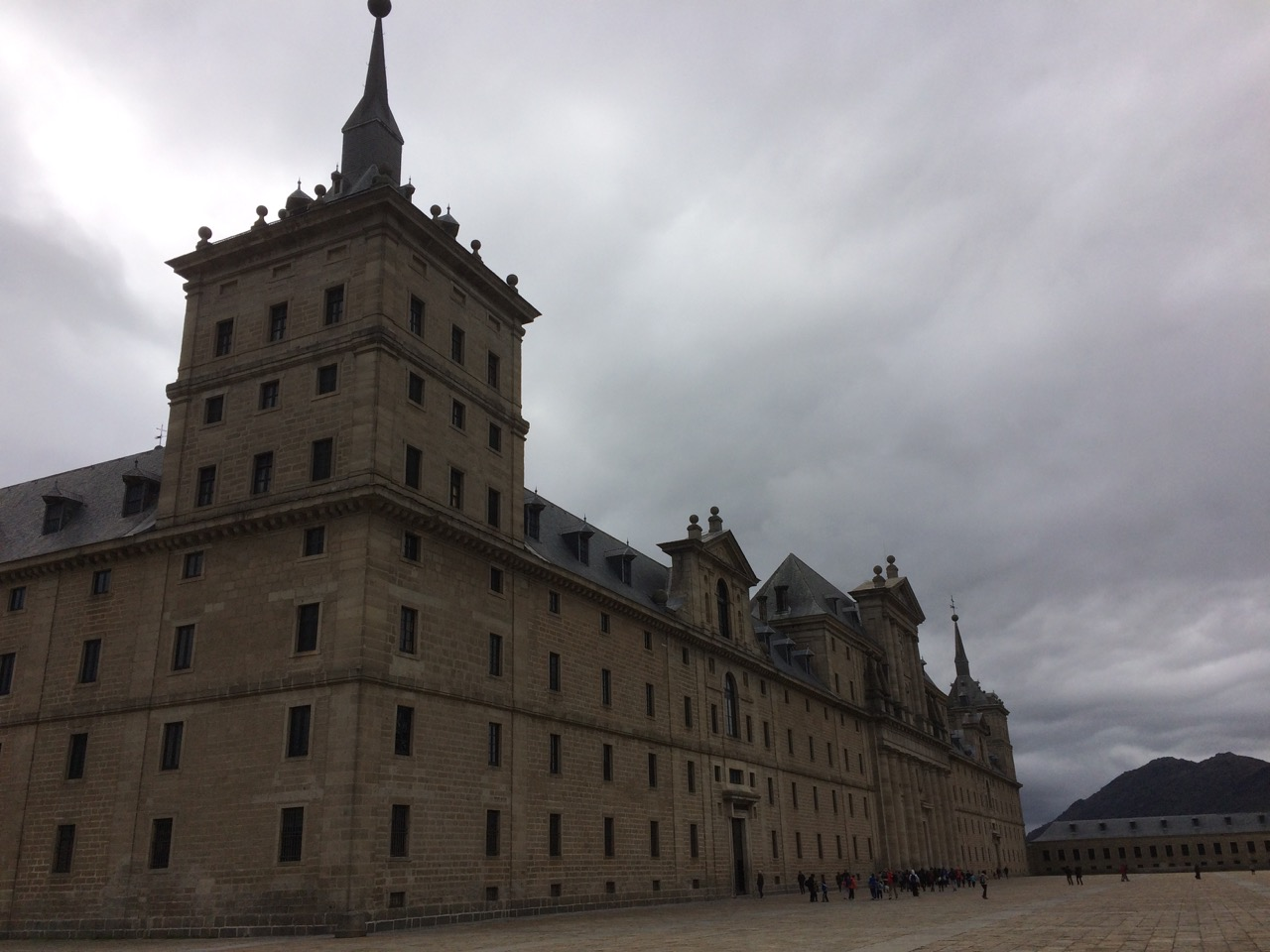 Under gray clouds it looks more like a fortress than a monastery or palace