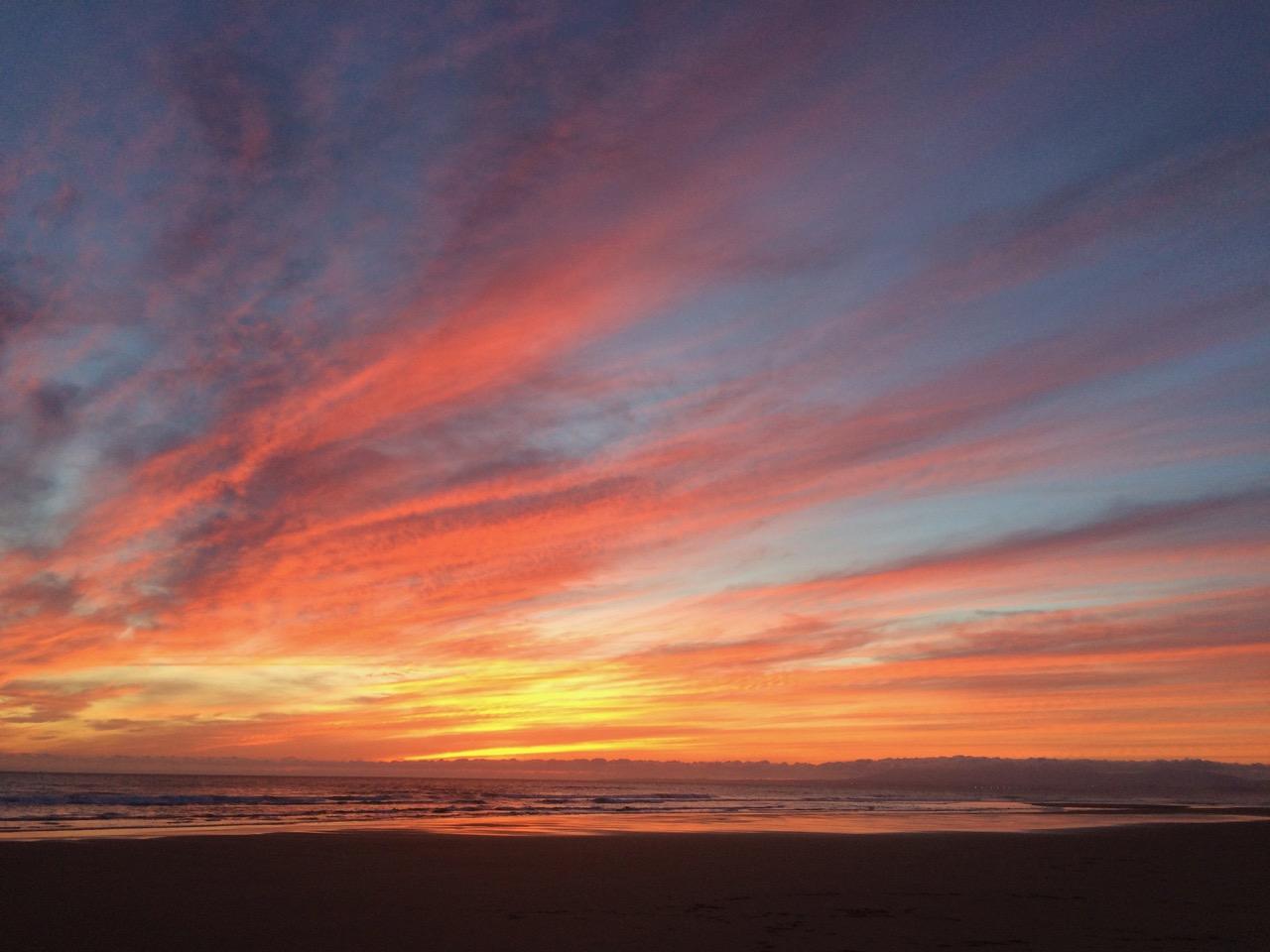 Dramatic sunset on Costa da Caparica, Portugal